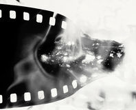 Film. Strip on fire monochrome image Royalty Free Stock Images