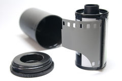 Film. Black and white film with open canister Royalty Free Stock Image