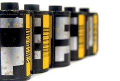 Film. A line of old film canister Royalty Free Stock Images