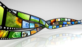 Film. Strip with images & reflection Royalty Free Stock Photo