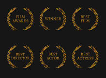 Film academy awards winners and best nominee gold wreaths on black background. Royalty Free Stock Photo