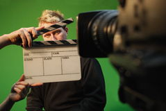 Film actor. In studio with green screen in background