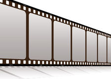 Film along. Piece of film standing up with a drop shadow and white background Royalty Free Stock Photos