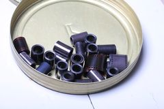 Film archive negatives in a round metal can. Old film archive negatives in a round metal can royalty free stock photos
