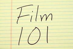 Film 101 auf einem gelben Kanzleibogenblock Stockfotos