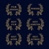 Film awards laurel logo. Film awards and best nominee gold award wreathed with laurel as a mark of honor on dark background Stock Photos