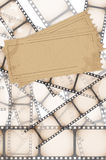 Film background. Grunge background - film strip on white background and two tickets Royalty Free Stock Image