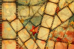 Film background. Grunge background - film strip on a stars background Stock Photo