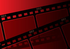 Film background. Design with film strip at red background Stock Photography