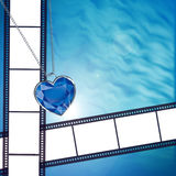 Film on background with blue diamond heart Royalty Free Stock Image