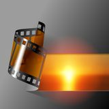 Film banner. Curled photo film strip with sea sunset background. Movies and Photo album cover. There is in addition a vector format (EPS 10 Royalty Free Stock Images