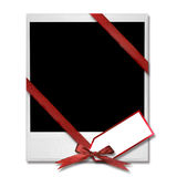 Film Blank With Christmas Bow and Gift Tag Royalty Free Stock Photography
