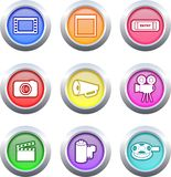 Film buttons. Collection of very colourful film buttons isolated on white Royalty Free Stock Photography