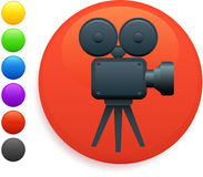 Film camera icon on round internet button Stock Photo