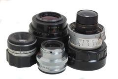 Film camera lenses. Old film camera optic lenses, used Royalty Free Stock Photos