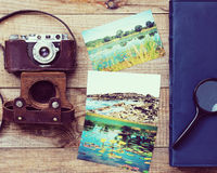 Film camera, magnifying glass, foto and photo album. Royalty Free Stock Image