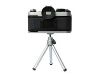 Film camera with mini tripod. On white background royalty free stock image