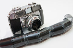 Film camera and negative. Vintage 35mm film camera and negative filmstrip Royalty Free Stock Images
