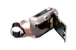 Film camera. Open camera with film on a white background Stock Image