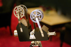 Film camera red carpet. Small film camera and red carpet Royalty Free Stock Photo