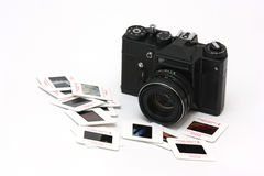 Film camera and slides Stock Photo