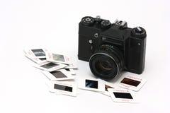 Film camera and slides stock photo
