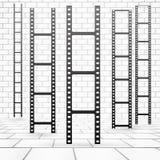 Film or camera strips near white brick wall.  Stock Photo