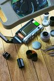 Film camera on a table under a magnifying glass Stock Photography
