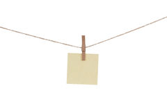 Blank paper cards hanging on clothespins Stock Photography