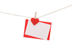Blank paper cards hanging on clothespins Stock Image