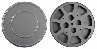 Film Can and Reel. Used 16mm film can and reel isolated on white background Royalty Free Stock Images