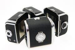 Film cartridges for 60mm film. On white background stock image