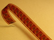 Film celluloid over a yellow background. Horizontal Stock Photography