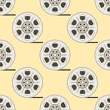 Film cinema technology seamless pattern vector twisted movie strip with round box roll illustration Stock Photo