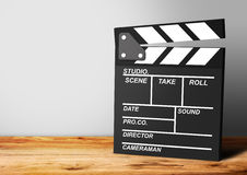 Film Clapboard on wooden background Stock Photo
