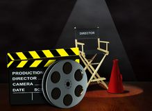 Film with clapper board and director chair. Film reel with clapper board and director chair Stock Photography