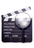 Film clapper board with magnifying glass cutout Stock Photo