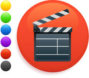 Film clapper icon on round internet button. 