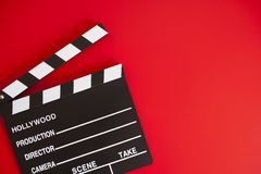 Film clapper on red background stock photo