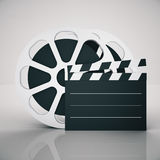 Film clapper and reel Royalty Free Stock Photo