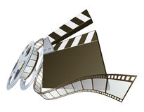 Film clapperboard and movie film reel. A clapperboard and film spooling out of film reel illustration. Dynamic perspective and copyspace on the board for your Stock Photos