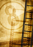 Film concept. Film strip on vintage texture Stock Image