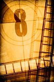 Film concept. Film strip on vintage texture Royalty Free Stock Photos