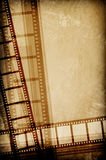 Film concept. Film strip on vintage texture Stock Photography