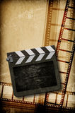Film concept. Film strip on vintage texture Royalty Free Stock Photography