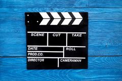 Film concept. Clapperboard on blue wooden background top view copyspace Stock Photography