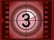 Film Countdown - At 3. Old Red Scratched Film Countdown at No 3 Royalty Free Stock Image