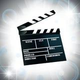 Film cracker. Over bright star background Stock Photos