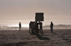 Film Crew. Setting up for sunset shoot at Noordhoek beach near Cape Town Stock Photo