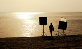 Film crew on a beach Stock Photo